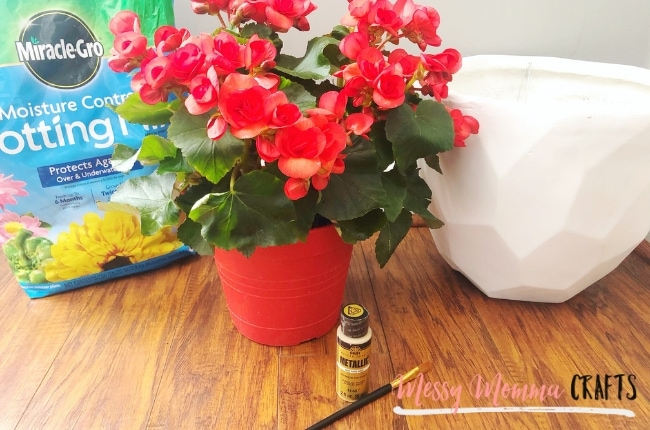 e your front porch with this Front Door Flower Pot painted with a beautiful metallic gold paint.