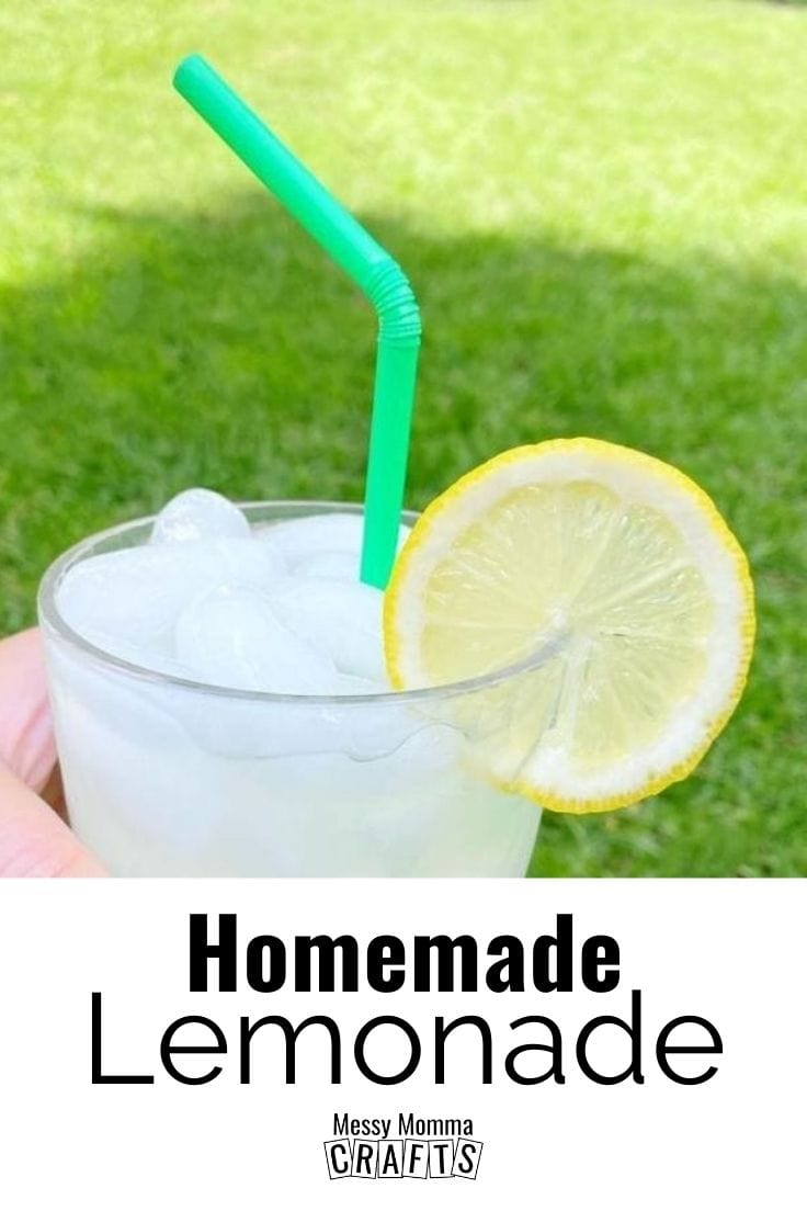 A clear glass of homemade lemonade with a lemon wedge for garnish.