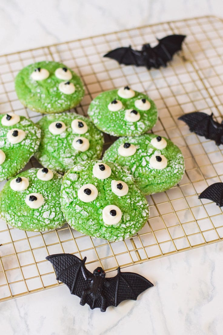 These Halloween Monster Cookies bring in the spook AND cuteness factor - all in one! Plus, they're really easy to make, and you probably have the majority of the ingredients already in your pantry.