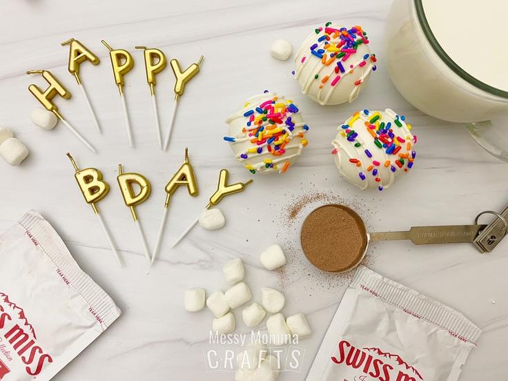 Birthday cake hot cocoa bombs with rainbow sprinkles.