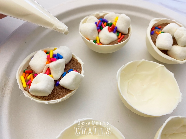 Adding marshmallows and sprinkles to chocolate and cocoa cups.