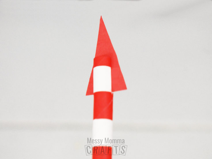 Red and white striped paper straw with a paper triangle at the top.