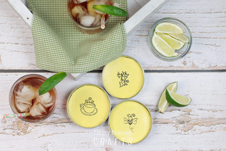 3 yellow coasters with drawing of a coffee cup, a bee, and some lettering.