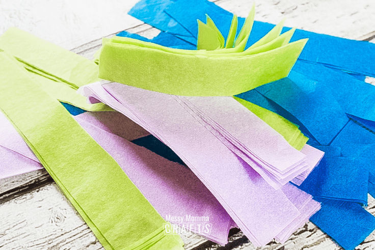 Cut tissue paper.