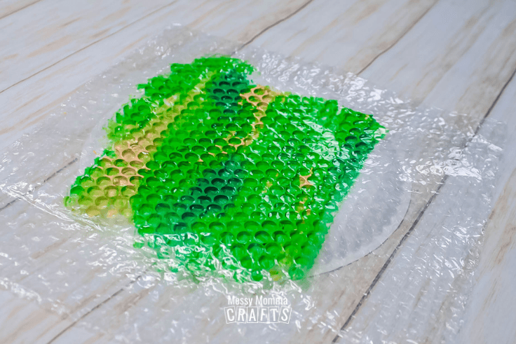 Painted bubble wrap on a paper plate.