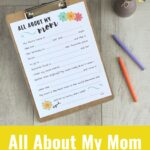 Free printable Mother's Day interview on a wood backdrop with two markers.