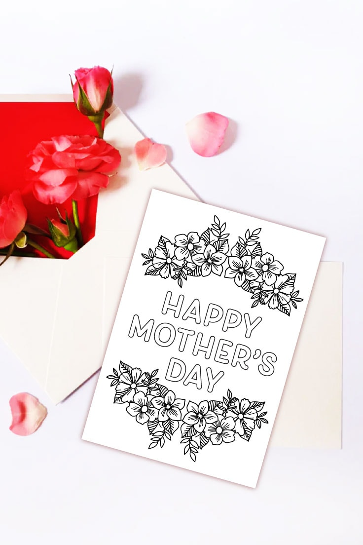 Preview of printable Mother's Day card on top of white envelopes with fresh pink flowers decoration.