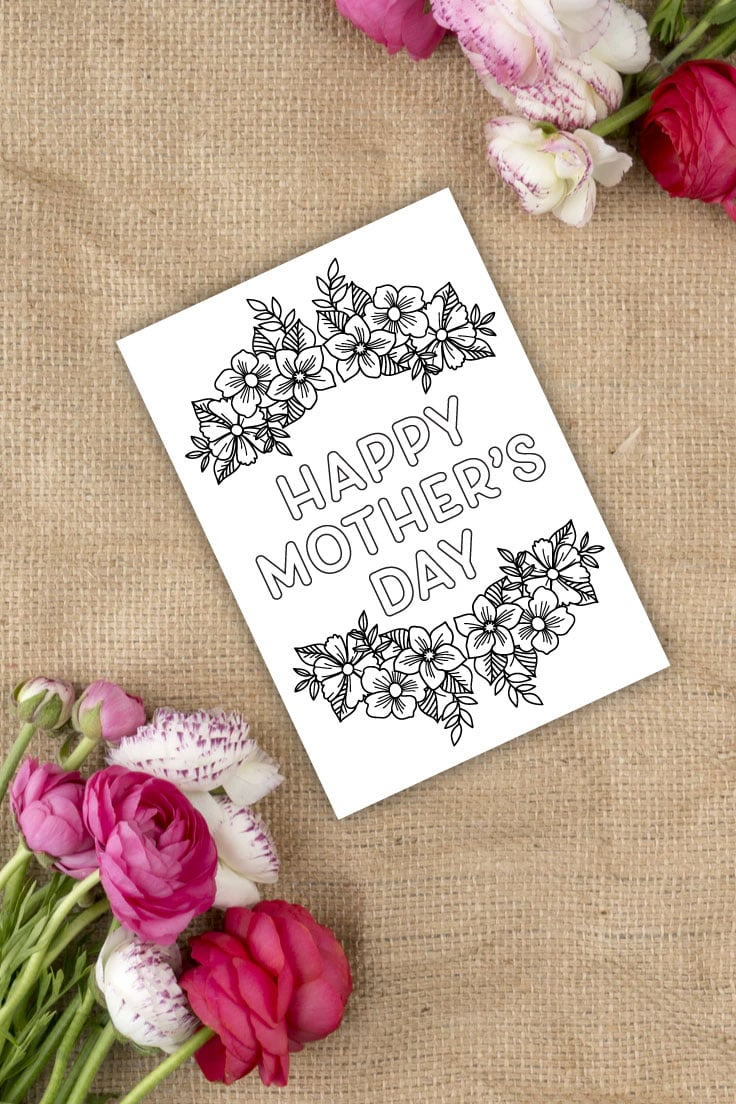 Preview of printable mother's day card for coloring on burlap with pink flowers on upper right and lower left corners.