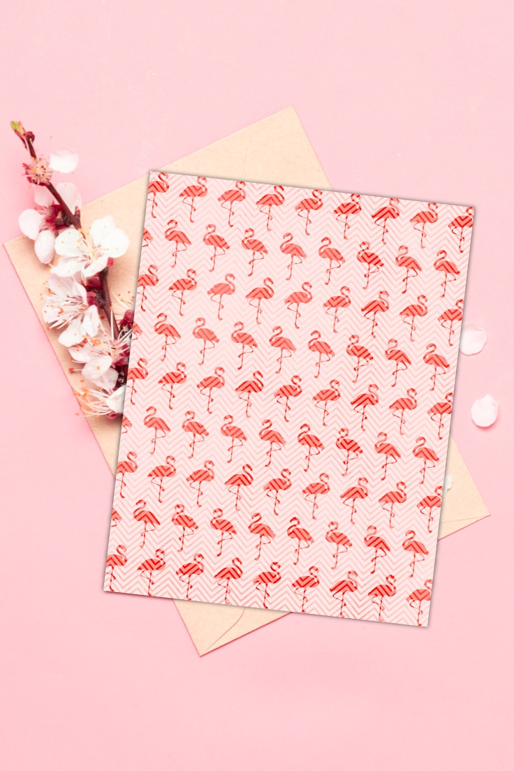 Preview of flamingo pattern printable on pink background with envelope and cherry blossom flowers.