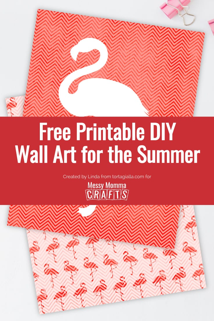 Preview of flamingo wall art printable on desk with clips.