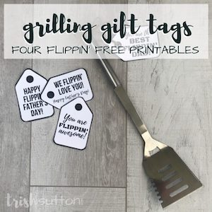 Grilling gift tags laying next to a grill spatula from Trish Sutton.