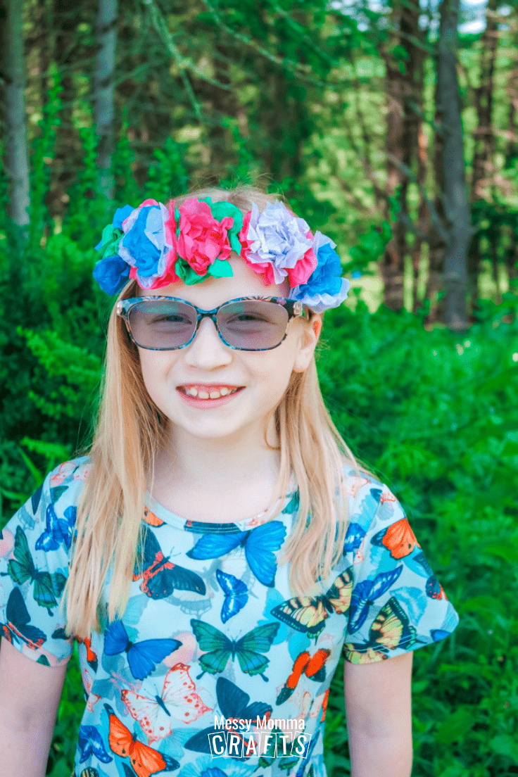 A child wearing a flower crown outdoors.