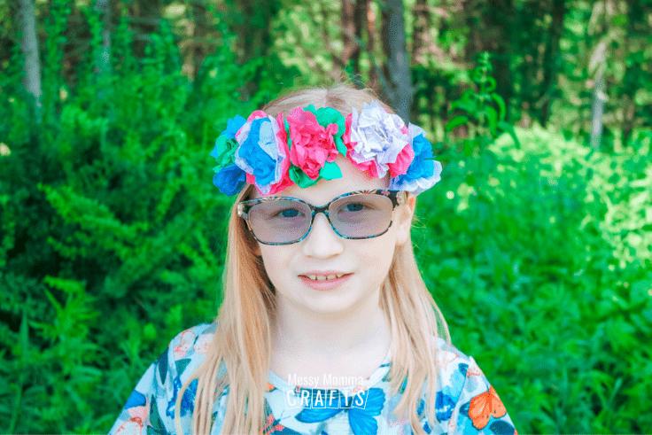 Child wearing a tissue paper flower crown.