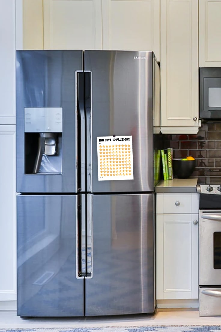 Modern kitchen with 100 day challenge color printable of 100 stars on a grey refrigerator door.