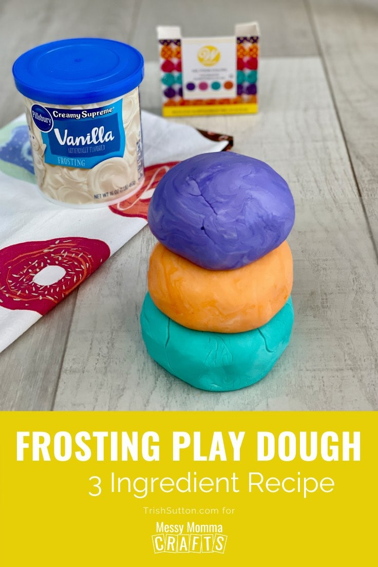Stack of three balls of play dough with a can of vanilla frosting & food coloring in the background.