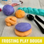 Edible Play Dough, plastic spoon & knife with a can of vanilla frosting in the background.