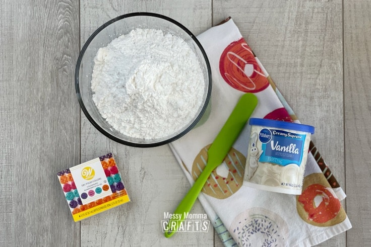 Ingredients for edible play dough on a wood background.