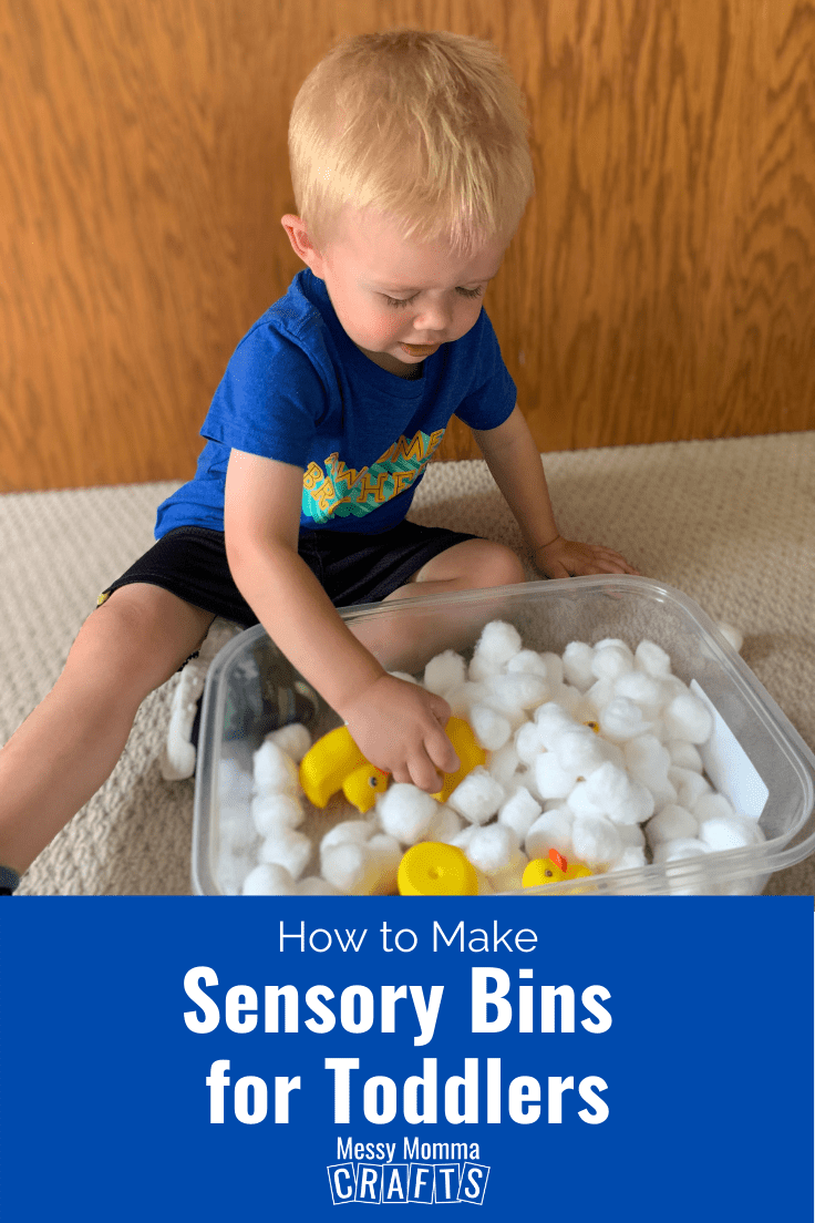 Toddler playing with a sensory bin.