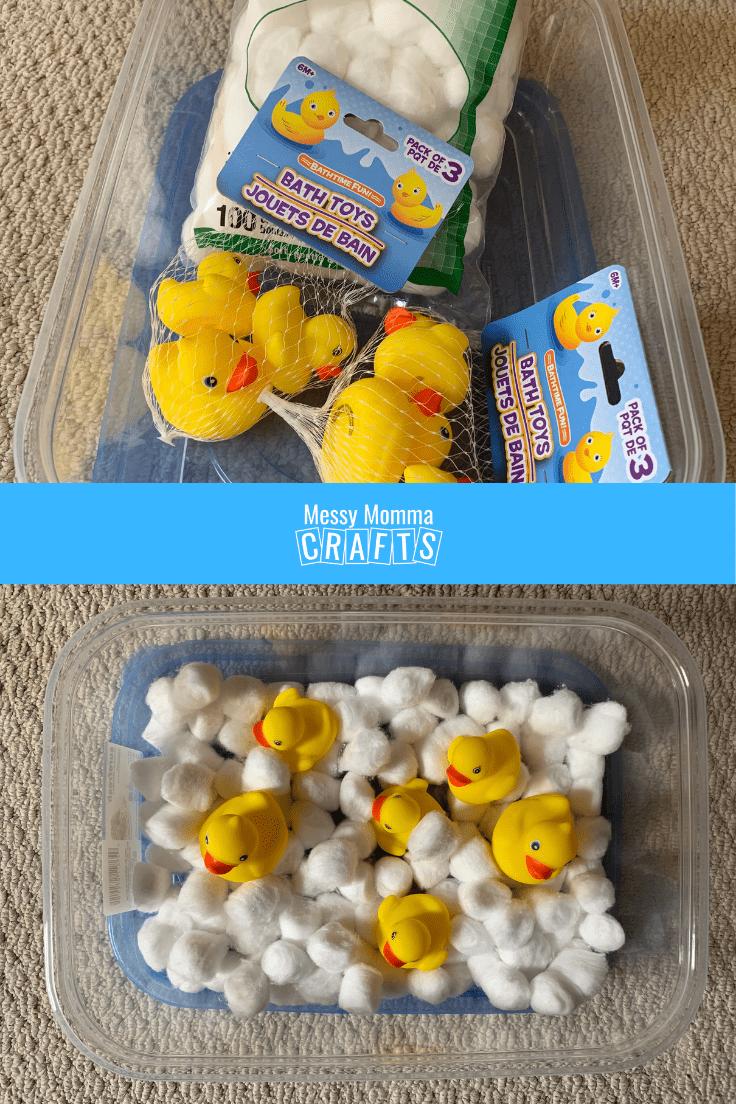 Sensory bin with cotton balls and mini rubber ducks.