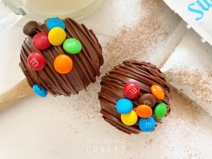 Two M&M hot cocoa bombs