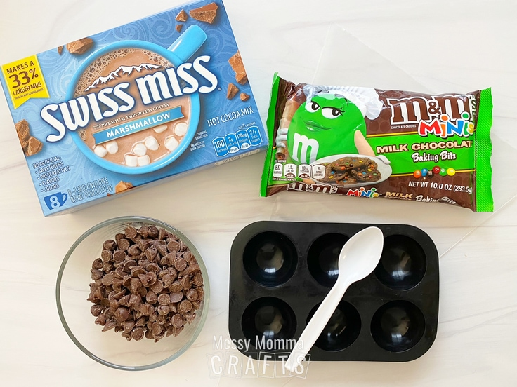 Swiss Miss hot cocoa, chocolate chips, M&M minis, and a silicone mold