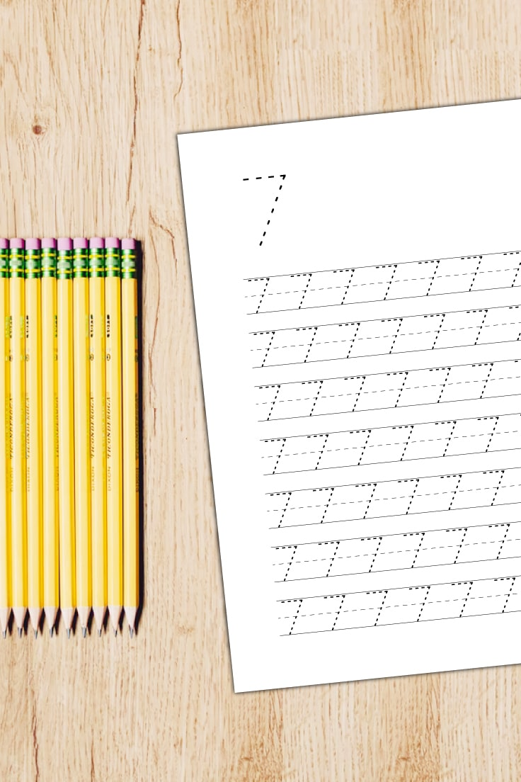 View of wooden desk with row of yellow pencils and preview of number 7 printable number to trace worksheet.